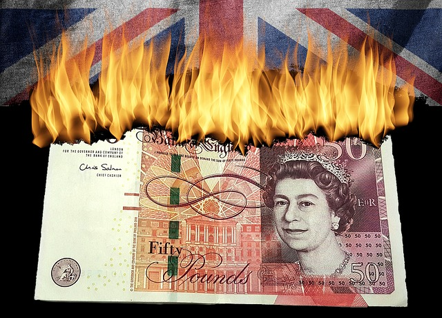 43% of small businesses do not answer the phone and are burning money. Image is a £50 note burning on the top edge under a union jack.