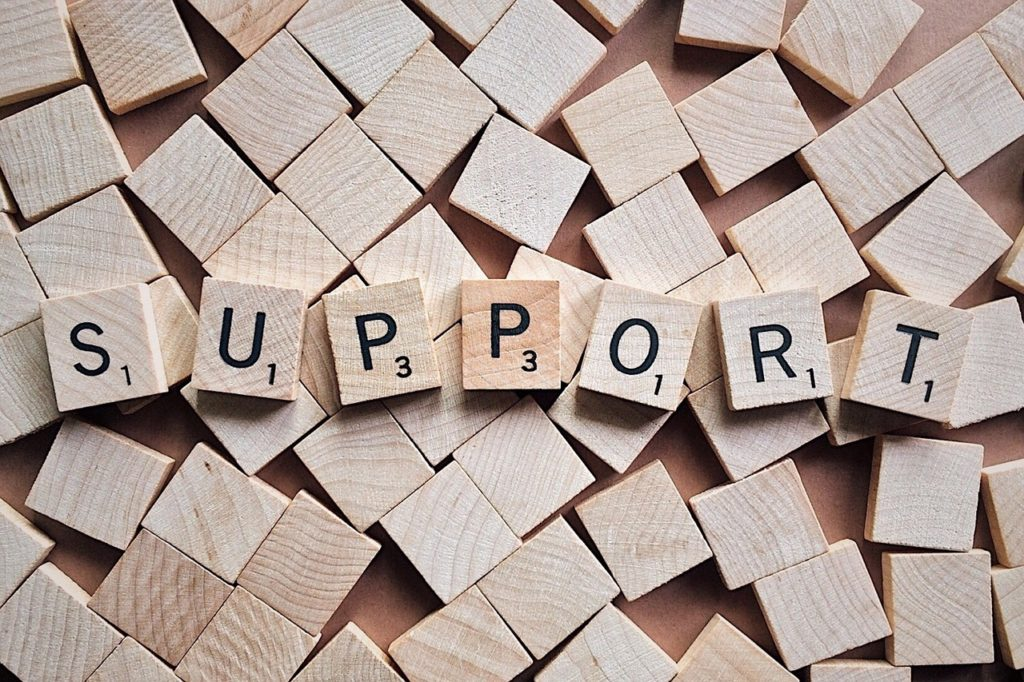 """Aaron Henriques is a finalist as the top UK business strategy advisor in a competition with Enterprise nation and Experian. Image reading """"support"""" made up of individual scrabble bricks."""